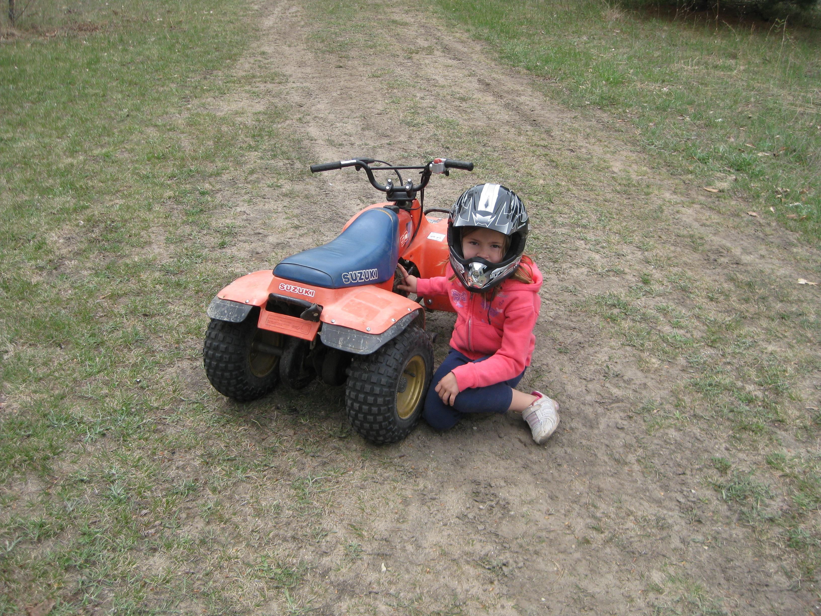 My baby girl riding her 1983 Suzuki Quad. Wolverine, MI 2012